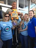 Cesar Milan sports an HT adoption vest and visits with HT volunteers at the National Family Pack Walk event